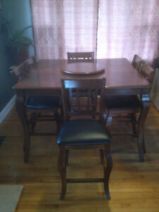 Pub style dining table in good shape comes with 8 chairs