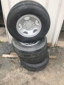 4 brand new LT245/75/16 tires on rims