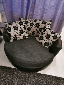 Large DFS cuddle swivel chair