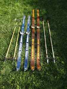 Two Sets of Cross Country Skiis and Poles