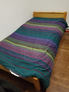 Solid Wood bed with great matteress. Clean in good shape