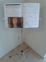 Guitar Method book with CD, and a music note stand