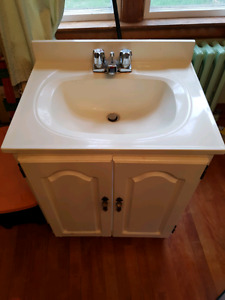 Bathroom vanity with counter and taps