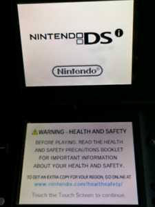 NINTENDO DSi SYSTEM WITH CHARGER AND GAMES