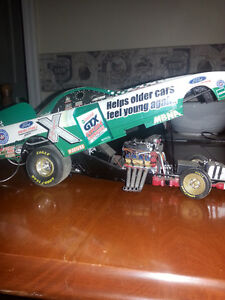 John Force 1/18 scale die cast funny car mint