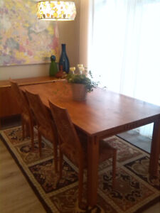 Dine in Elegance on this Contemporary Hardwood Dining Table