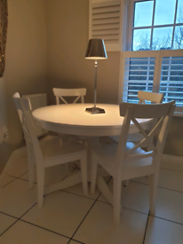 Ikea Ingatorp extending dining table, white with four matching chairs.