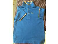 Boys' Lacoste size 6 polo shirt in excellent condition.