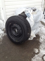 BRAND NEW SET OF 4 BRIDGSTONE BLIZZAK TIRES with rims.