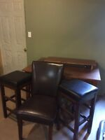 Table 4 leather chairs and 2 leather bar stools