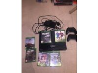 Xbox One with two controllers and 6 games