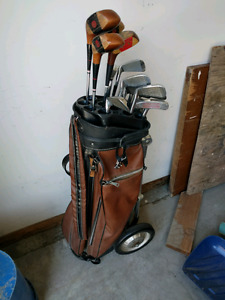 Vintage golf clubs with bag and cart