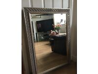 This is quite a big mirror in a silver tone frame