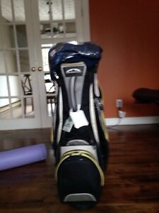 Used cart golf bag and two new golf shirts