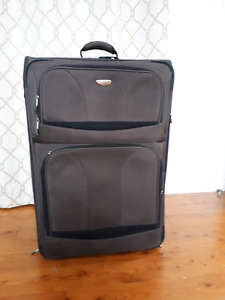 Large brown tracker suitcase / luggage