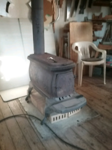 Cast iron wood stove and wood