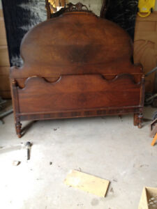 antique headboard and footboard , with dresser.