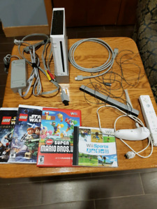 Used Wii, controller and 4 games