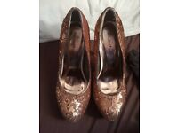 Brand new size 6 gold sequin heels