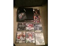 Slim Sony PS3 console with games