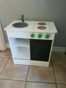 Kids toy pretend kitchen with dishes and food