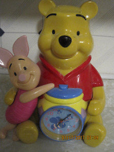 Disney Winnie the Pooh and piglet musical alarm clock and bank.