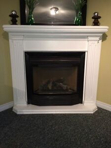 Gas fireplace with solid wood mantle