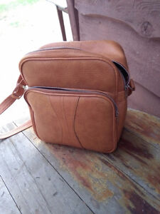 one of a kind small luggage bags