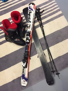 Children skis, poles, boots and helmet