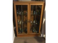 Two teak effect glass fronted display cabinets