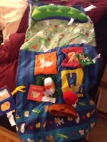 Infantino shopping cart cover with toys