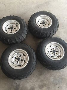 Stock tires and rims off of a 2014 Honda rincon.