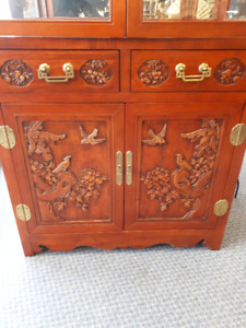 Heavily Carved Oriental Cabinet