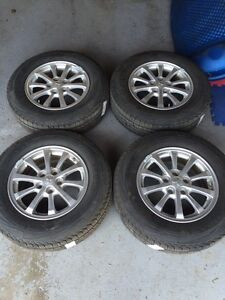 4 All season Kumho Tires and Rims Almost New!