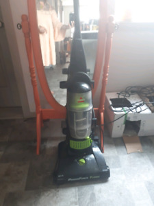 Bissell vacuum and wooden pub height wooden table