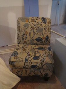Comfy upholstered chair with matching cushions
