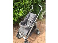 Silver cross buggy witch converts into a carry cot with a carry cot insert in average condition for