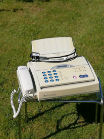 Fax machine with telephone