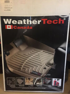 Weather tech floor mats for front and back and a trunk liner