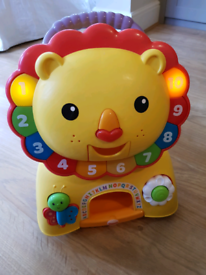 Fisher-Price Lion ride on/baby walker