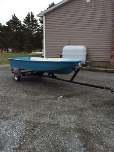 12 foot fiber glass with trailer and like new motor