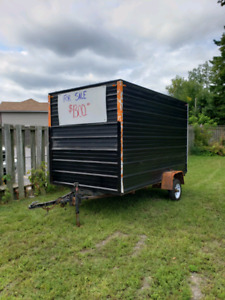 Snowmobile trailer enclosed with ramp