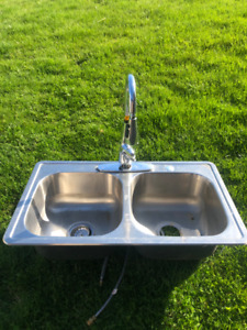 Double stainless steel sink and  a moen brand faucet