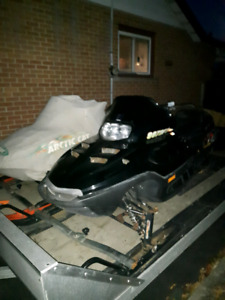 Two snowmobiles for sale