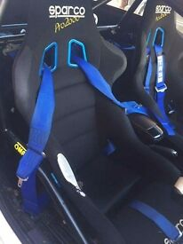 Sparco pro2000 seats plus TRS harnesses. Slight rip on one of the seats. Been taken out a corsa D.