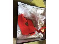 Unworn red heels UK size 6