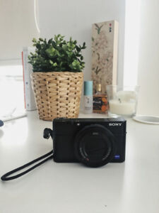 Sony RX100 IV camera w/ leather case and extra batteries