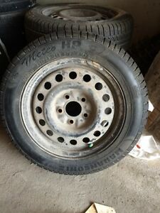 Set of 4 winter tires and rims.