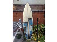 """6'4"""" fibreglass hand shaped surfboard"""