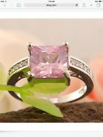 Beautiful ladies pink gemstone ring with cubic zirconias on side